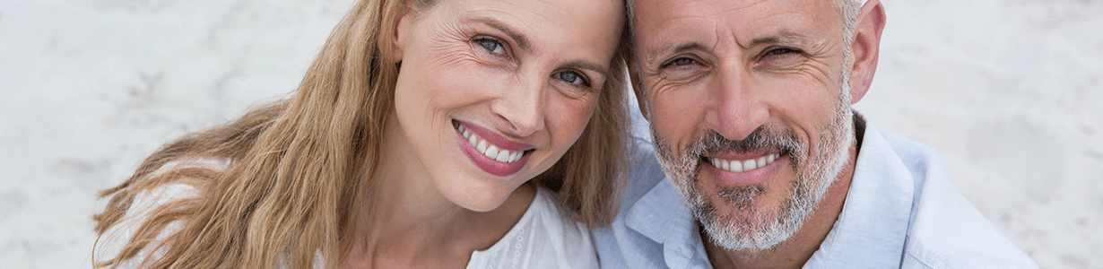 A Caucasian couple with dental implants.